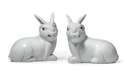 A PAIR OF WHITE RABBITS