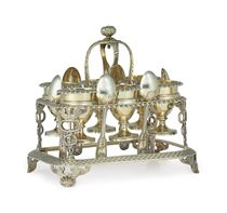 A GEORGE III ROYAL SILVER-GILT EGG FRAME AND SIX CUPS