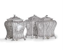 A SET OF THREE GEORGE II SILVER TEA AND SUGAR CADDIES