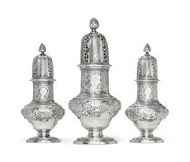 A SET OF THREE GEORGE II SILVER CASTERS