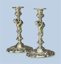 A PAIR OF GEORGE II SILVER-GILT CANDLESTICKS