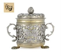 A CHARLES II PARCEL-GILT SILVER PORRINGER AND COVER