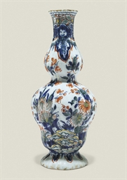 A DUTCH DELFT RIBBED VASE