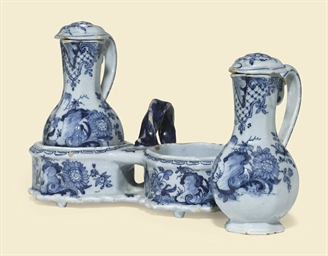 A DUTCH DELFT CRUET STAND WITH