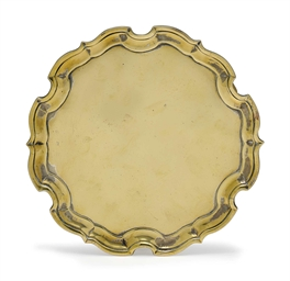 A GEORGE II BRASS SALVER