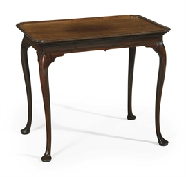 A GEORGE II MAHOGANY TEA TABLE