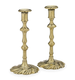 A PAIR OF GEORGE II BRASS CAND