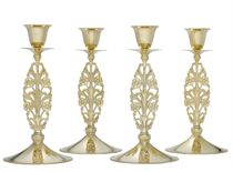 A SET OF FOUR SILVER-GILT CANDLESTICKS