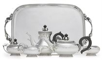 A FIVE-PIECE SILVER TEA AND COFFEE SERVICE WITH TRAY