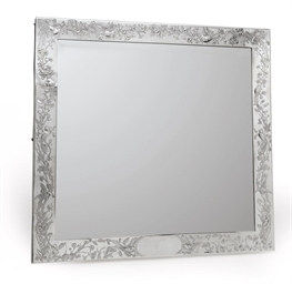 A SILVER-MOUNTED MIRROR