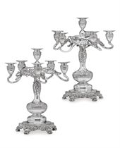 A PAIR OF SILVER SIX-LIGHT CANDELABRA