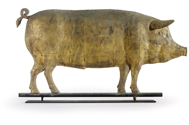 A MOLDED AND GILT COPPER PIG W