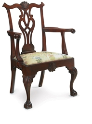 A CHIPPENDALE CARVED WALNUT OP