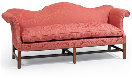 A CHIPPENDALE UPHOLSTERED SOFA