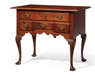 A QUEEN ANNE CARVED WALNUT DRE