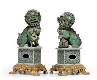 A PAIR OF BISCUIT-GLAZED BUDDH