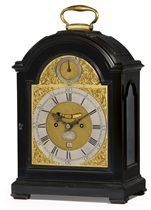 A GEORGE III EBONISED STRIKING EIGHT DAY TABLE CLOCK