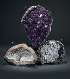 AN AMETHYST GEODE WITH CALCITE