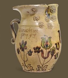 A GERMAN REDWARE LARGE JUG