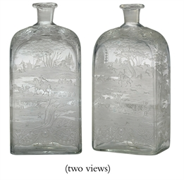 A CONTINENTAL GLASS BOTTLE