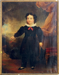 Portrait of a young boy holding a cap