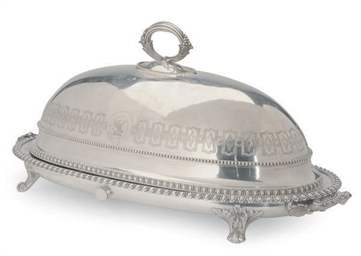 A SILVER-PLATED FISH DISH AND