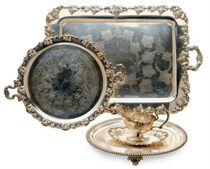 AN ASSEMBLED SET OF SILVER-PLATED TABLE SERVING PIECES,