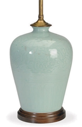 A CHINESE CARVED CELADON JAR M