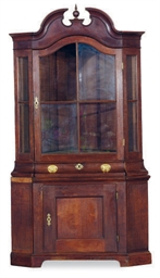 A DUTCH OAK CORNER CUPBOARD,