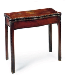 AN IRISH MAHOGANY CARD TABLE,