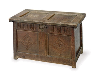 AN OAK COFFER,