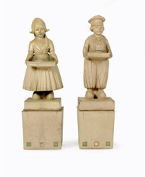 A PAIR OF STONEWARE FIGURAL VI