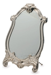 A SILVER-PLATED VANITY MIRROR,