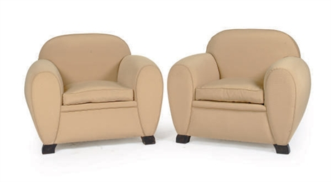 A PAIR OF TAN UPHOLSTERED CLUB
