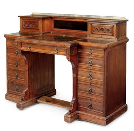 A MID-VICTORIAN CARVED WALNUT