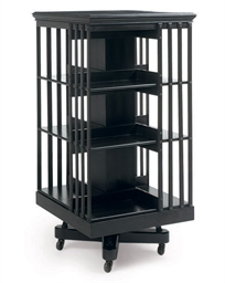 AN EBONISED THREE-TIER REVOLVI