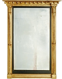 A REGENCY GILTWOOD WALL MIRROR