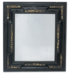 AN EBONISED RIPPLE-MOULDED AND