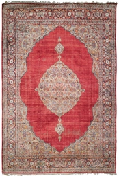 An antique silk Tabriz carpet