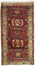 AN ANTIQUE YURUK LARGE RUG