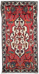 A BAKHTIARI SMALL CARPET