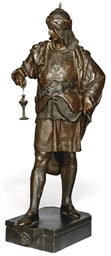 A BRONZE FIGURE OF A MOORISH W