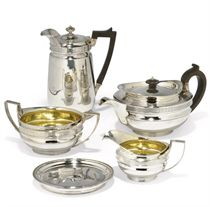 A GEORGE III SILVER MATCHED FIVE-PIECE CAPE PATTERN TEA AND COFFEE SET