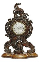 A VICTORIAN CARVED WOOD EIGHT DAY TIMEPIECE TABLE CLOCK
