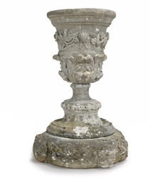A COTSWOLD STONE URN AND PLINT