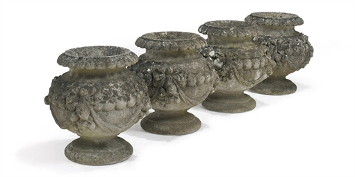 A SET OF FOUR ARTIFICIAL STONE