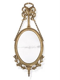 A DANISH GILTWOOD OVAL MIRROR