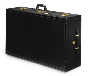 A LARGE SUITCASE WITH SHOE STO