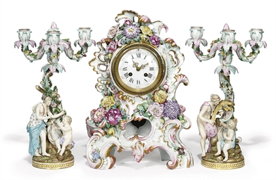 AN ASSEMBLED CLOCK GARNITURE