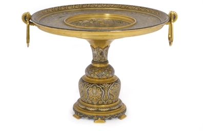 A SPANISH GILT AND PATINATED B
